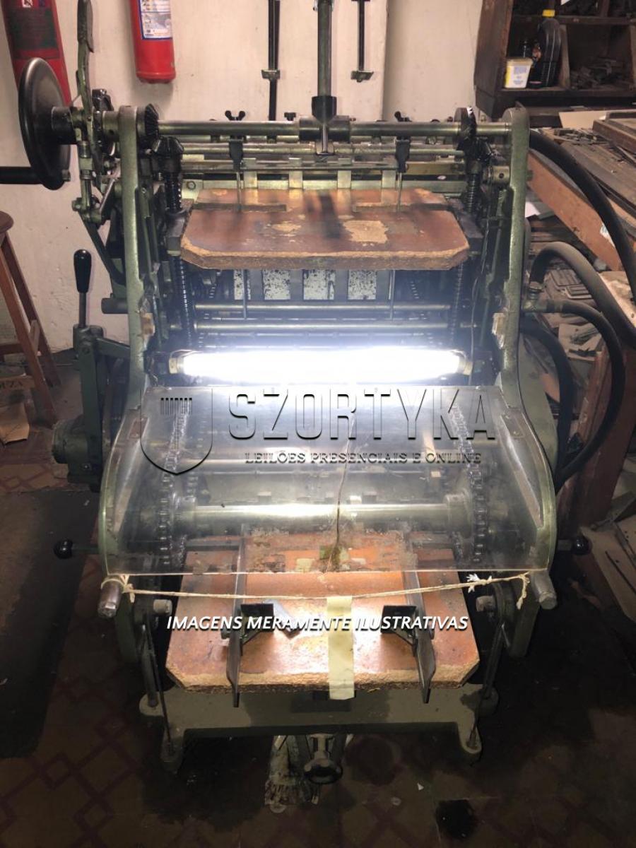 01 (uma) impressora tipográfica plana automática